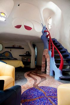"""Sullivan calls the living room his man cave: It's a warm space with starry tile work and a fireplace tucked under a staircase leading to a sleeping loft. The tiled floor design? """"Random madness,"""" he said."""