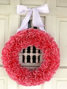 So would love this for Valentines day....How to make a cup cake liner wreath