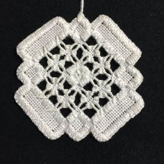 Diamond ornament stitched in hardanger embroidery. Custom orders are available. Size is approximately 3 square.