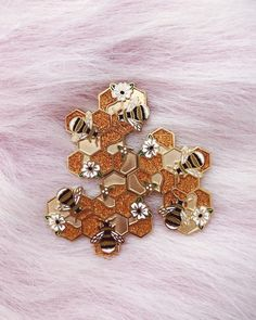 honeycomb floral glitter honey bee flowers enamel lapel pin badge by lilly baik. Jacket Pins, Hard Enamel Pin, Cool Pins, Metal Pins, Pin And Patches, Up Girl, Pin Badges, Lapel Pins, Pin Collection