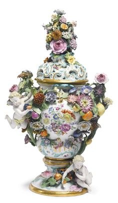 A MEISSEN FLOWER-ENCRUSTED POTPOURRI VASE AND COVER THIRD QUARTER 19TH CENTURY of inverted pear form, painted with colorful flower arrangements, the shoulders set with twig handles, crossed swords mark in underglaze-blue.