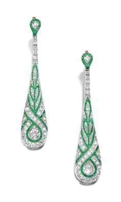 PAIR OF EMERALD AND DIAMOND EAR PENDANTS/ Each tapered drop millegrain-set with calibré-cut emeralds, highlighted with circular-cut diamonds, hinged post fittings. Art Deco or Art Deco style