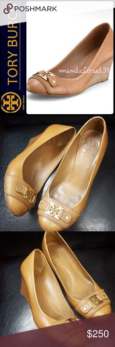 Tory Burch Leather Wedge Tory Burch Signature Shoes in Gorgeous Leather! Features the Rare Luggage Royal Tan Shade with Iconic Gold Tory Logo Emblem on Vamp! Rich Tumbled Leather Upper and Lining Giving a Nice Chic & Class!  Made In Brazil, Mid Wedge Heel about 2.5 Inches! Easy to Handle Lift with Slight Padded Footbed! Gives the Nine to Five Edge of All Day Walking Comfort! Tonal Stitching DetailsThroughout! Used with Signs of Wear, Lots of Life Left! Size US 8M! 1st Pic is Stock Photo…