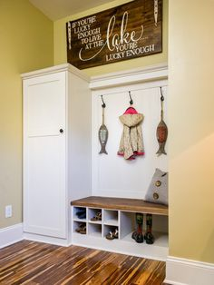 A mudroom-inspired storage system keeps clutter and outside elements from coming into the home. A few wise words painted on distressed wood is a suitable design statement for the lucky winner of Blog Cabin 2014.