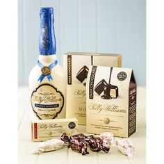 A gift hamper with Sally Williams cream liqueur, chocolate coated nougat and a soft nougat bar, presented in a gift box. Delivery throughout South Africa. International Florist, Nougat Bar, Cream Liqueur, Biltong, Chocolate Coating, Gift Hampers, Chocolate Gifts, Sally, Presents
