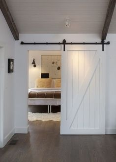#make #barndoor   Les made double rolling barn doors for our living room.  This version is super cute.