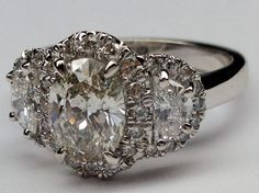 this ring is growing on me, and my love of anything moon related doesn't help... oval engagement ring half moon side stones