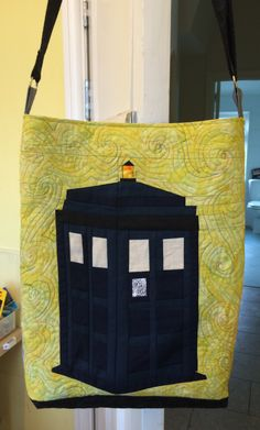 Dr Who's Tardis paper pieced, quilted and made into a bag with a Weeping Angel on the other side.