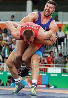 Bulgaria's Elis Guri wrestles with Sweden's Carl Fredrik Stefan Schoen