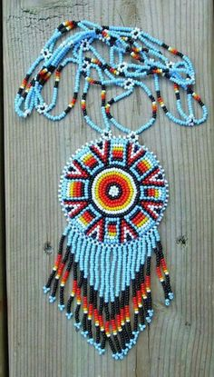 american native necklace by deancouchie on Etsy, recently was at a pow wow n the women selling hers told me how she made them.one bead at a time. that would take me forever ! Native Beading Patterns, Beadwork Designs, Bead Loom Patterns, Indian Beadwork, Native Beadwork, Native American Beadwork, Collar Indio, Native American Crafts, Nativity Crafts