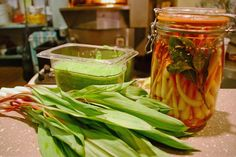 Two of the three recipes we prepare today on Earth Eats using ramps (wild leeks): ramp pickles and ramp pesto. — Photo: Alycin Bektesh (for WFIU)