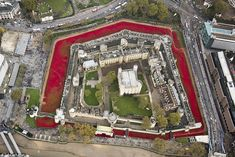 The Tower surrounded: In a spectacular aerial image, the sea of red poppies encircles the Tower of London yesterday.