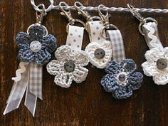 Thought these were cute... Crochet key rings - no tutorial, but I guess if you know how to make the heart and flowers you can do this. @Sheila Mohler