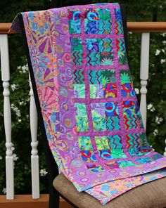 Modern Patchwork Baby Quilt done in Kaffe Fassett fabrics, by Poppety Quilt at Etsy. It's a deal.