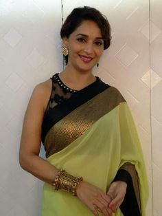 Madhuri Dixit Nene was seen on the sets of her dance reality show, 'Jhalak Dikhla Jaa' in a beautiful yellow saree by Atsu. Pink lips and simple jewe. Madhuri Dixit, Bollywood Saree, Bollywood Fashion, Saree Fashion, Indian Celebrities, Bollywood Celebrities, Celebrities Fashion, Indian Beauty Saree, Indian Sarees