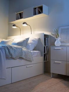 Wooden headboard from Ikea with built in storage.
