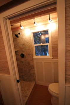 LOVE this look of this bathroom....the tiled shower and the white chair rail....in love!!