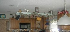 hung an old ladder from my ceiling and decorated with old kitchen utensils. Draped an old good housekeeping magazine from one of the rungs Bay Window Curtains, Burlap Curtains, Window Seats, Old Ladder Decor, Diy Ladder, Windows And Doors, Bay Windows, Painted Furniture, Furniture Design