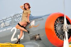 Hot dame and a vintage plane... i am sold. - Salute Our Veterans by Supporting the Businesses of www.VeteransDirectory.com and Hiring Veterans. Post Jobs at www.HireAVeteran.com