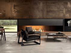 Habillage de cheminée contemporaine en carrelage aspect métal brun, Intramuros Rust. Pour plus d'infos : http://www.portovenere.fr/fr/carrelage/carrelage-contemporain-et-design/carrelage-contemporain-aspect-metal-intramuros/