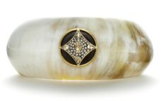 Horn cuff with 18k gold with ebony wood, 0.255 ct. t.w. diamonds, and moonstone pavé, $4,000; Anahita