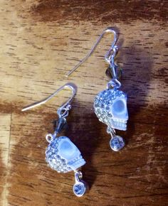 Do you need a little glitz and glam? You may want to give these crystal encrusted skulls a whirl! A pale gray Swarovski crystal sits above the