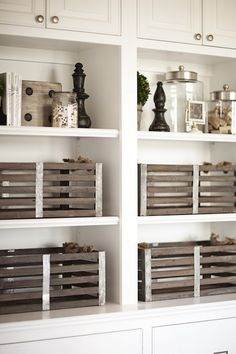 White built-ins with vintage wood crates