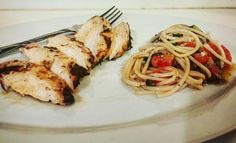 Lemon thyme n garlic marinated Grilled chicken breast.  With side of shaved garlic n blistered tomato spaghetti Aglio e Olio.