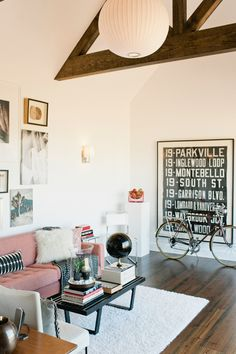"""using a massive painting/print to take up more space (over small prints/paintings) is a cheaper (fewer frames) and more versatile way to decorate. Paint a piece of drywall or lightweight wood with chalk-board paint, and have at it with your own designs, a checklist, or use it for smaller prints and draw your own """"frames"""""""