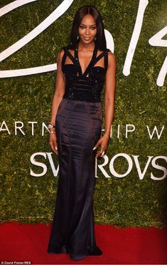 NAOMI CAMPBELL – Naomi looked regal and hot in her figure-hugging, skin-baring Alexander McQueen gown with sultry, cage-y cut out details.