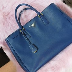 Prada Saffiano Tote in Royal Blue 100% Authentic Prada Saffiano Gardener's Tote. Minor wear at 3 bottom corners. Otherwise great condition. Interior includes 2 pockets and one zip pocket. Beautiful royal blue color. Dustbag included. Update: Kind of fell in love with it over again. For now, it's not for sale. Prada Bags Totes