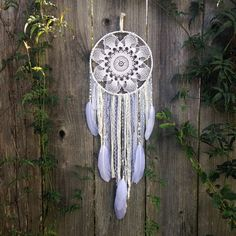 Handmade, white Dreamcatcher with vintage doily, by Inspired Soul Shop. This boho decor piece helps for a peaceful and blissful sleep each