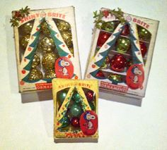 Set of three boxes of dollhouse Christmas ornaments. Beads from Mardi Gras necklaces were used to make the ornaments in the boxes.