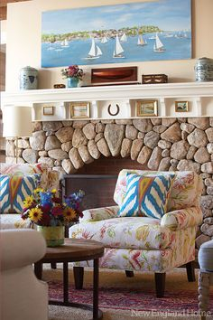 What a fireplace! A primitive scene of Edgartown, MA, painted by Eveline Roberge hangs above it.