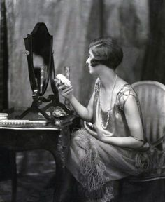 An elegant 1920s woman at her vanity. #vintage #1920s #beauty
