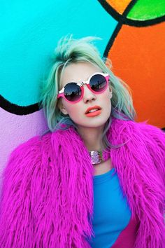 Bold coloured fashion editorial - bright pink fur coat and round glasses - http://pinterest.com/arenaint