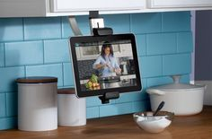 something like this that will hide away when not in use for ipad for using recipes, etc in kitchen