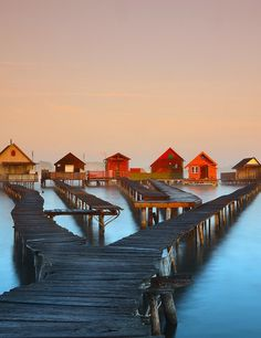 Bokod is a village in Hungary and is not a tourist destination. It is barely visited – it's just an old village on a lake. Along the lake shore, rickety boardwalks lead out over the lake to old fi...