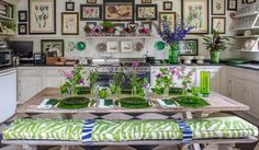 Summer is a year-round event in Butter Wakefield's Victorian villa in Stamford Brook, west London. From the hallway papered with a pattern of palm fronds to the botanical prints on the kitchen wall and lettuce ware china in the conservatory, every room is decorated with foliage and flowers, in print and pattern, on fabric and in vases wherever there is a ledge, sill or tabletop.
