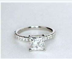 Princess cut diamond scallop set round brilliant cut diamonds