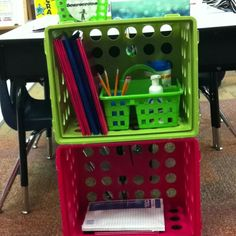 Crates zip-tied to each desk group with all the essentials. Off their desks and out of the way!
