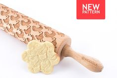 Engraved rolling pin with Rooster & Hen pattern.  The wooden rolling pin for making cookies. The dough can be made of salt-, sugar- or