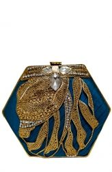 A striking blue clutch that is crafted from raw silk is the perfect accessory to carry on a night out. The glamorous Meera Mahadevia clutch is adorned with beautiful golden hand embroidery. At the top by the clasp are four jewels which give it a charming appeal.