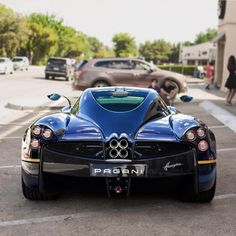 Pagani Huayra painted in Metallic Blue w/ exposed carbon fiber and yellow accents  Photo taken by: @dcw_supercars on Instagram