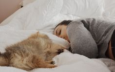 Girl sleeping with puppy
