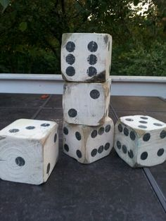 "Free wood from my brothers deck+inspiration from Pinterest= Lawn dice . We love them.  They are both decorative and functional! I used 4x4 post cut to 3 1/2"" , left over paints and a sander to distress them a little."