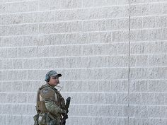 A police officer guarding the site of the attack in Texas last week. GREGORY CASTILLO / The Dallas Morning News via AP