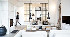 Naja Munthe's modern living room comes alive with these black framed windows.