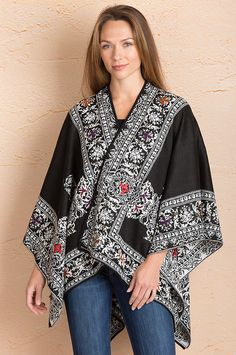 With its soft, rich texture, this colorful shawl beckons with an extraordinary layer of warmth, outdoors or in.