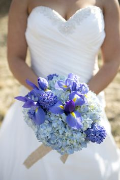 Purple and blue bouquet, Iris' and Hydrangeas  Burlap wrap  Photo By Angela Fortin Snyder Photography
